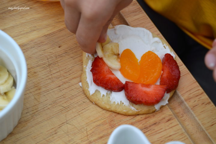 decorating rainbow fruit cookies